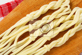 Fotografie slovak cuisine  string cheese in the shape of little braids korbaciky