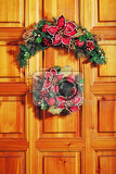 christmas wreath on front wooden door