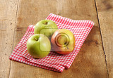 Fotografie three fresh apples on a rustic table