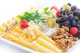 cheese plate with grapes nuts and fruits