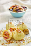 plum potato dumplings topped with fried bread crumbs with melted butter
