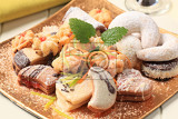 Fotografie variety of sweet cookies on golden plate