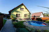 repaired rural house fixed facade insulation and painted to green  color witg swimming pool