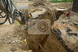 Fotografie excavator ploughshare on trench  constructing canalization in european project  wastewater treatment plant ecology project