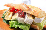 sub sandwich with white rind cheese and lettuce