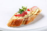 slice of baguette with butter radish and cress