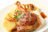 roast duck leg with potato dumplings and white cabbage