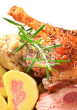 Photo dish of roast duck leg with dumplings