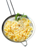 cooked bow tie pasta in a sieve