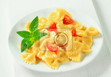 bow tie pasta with cream sauce and tomato