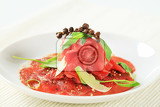 beef carpaccio with parmesan shavings and arugula