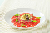beef carpaccio with lemon ground pepper and spring onion