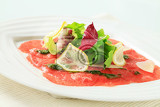 beef carpaccio with pesto salad greens and parmesan