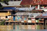 Photo poor houses with sheet tin by the river kota manado north sulawesi indonesia