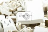 pile of scattered white keyboard keys on white background