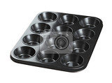 Fotografia 12 cupcake baking tray isolated on white