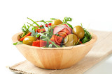 salad greens with  green olives and diced paprikacoated cheese