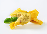 caramelleshaped stuffed pasta on white background
