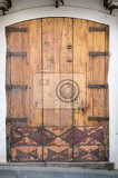Fotografie old door with wrought iron in tuscany italy