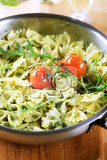 bow tie pasta with pesto and arugula