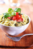 bow tie pasta with pesto and tomato