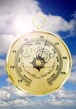 Fotografie barometer with cloudy sky in the background