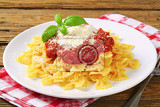 bowtie pasta with thick tomato sauce and parmesan