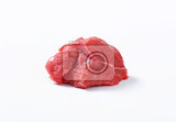 chunk of raw beef steak on white background