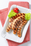 grilled vienna sausages  on white porcelain plate