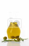 olive oil in clear glass carafe