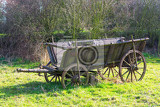 old wooden horse drawn wagon standing on grass