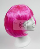 pink wig on a white mannequin head
