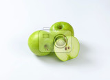 Fotografie two whole and half a green apple