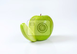 Fotografie green apple  a wedge cut off