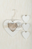 Fotografie valentines wooden hearts on white fabric  valentines day day valentine postcard with space for text