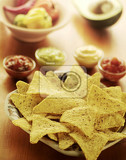 tortilla chips and various dipping sauces
