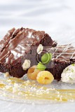 chocolate brownies served with ice cream and raspberries