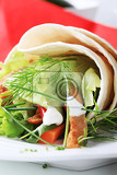 Photo vegetarian wrap sandwich with strips of soy meat