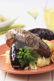 blood sausage and white pudding with sauerkraut and potatoes