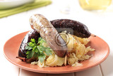 Fotografie blood sausage and white pudding with sauerkraut and potatoes