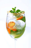 glass of iced drink with lime kumquat and mint