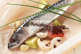 raw mackerel and other ingredients on parchment paper
