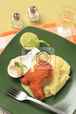 Photo fried breaded dinosaurshaped nugget with potato puree