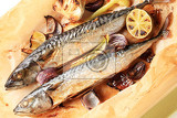 baked mackerel and vegetables on parchment paper