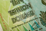 Photo macro of zimbabwe twenty billion dollars banknote now void currency inflation concept