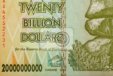 Fotografie macro of zimbabwe twenty billion dollars banknote now void currency inflation concept