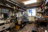 Photo real dirty domestic diy home workshop full of tools untidy ready for work