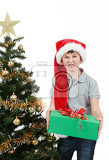 surprised boy in santa hat with christmas present on white background