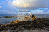 small temple on the shore by the sea with dramatic sky bali nusa penida indonesia