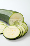 sliced fresh zucchini on a white background